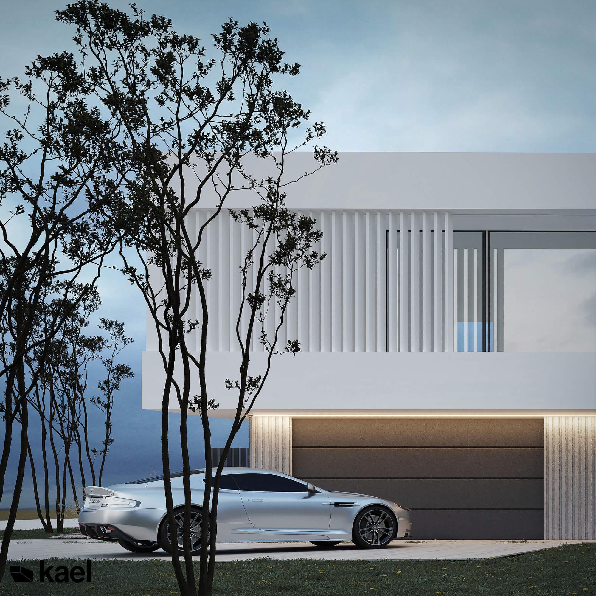 Aston Martin przed garażem domu
